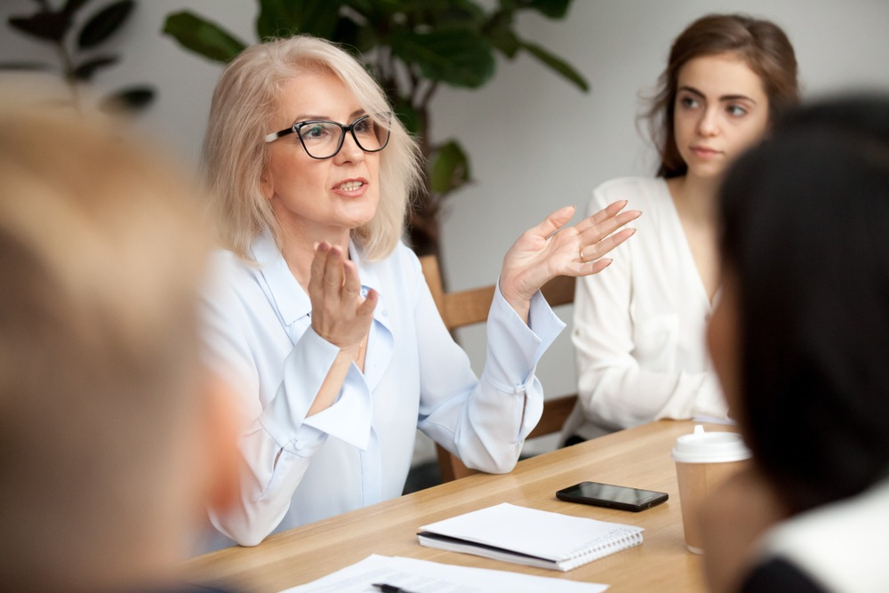 woman with dentures in meeting