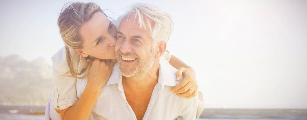 couple at beach man has dentures