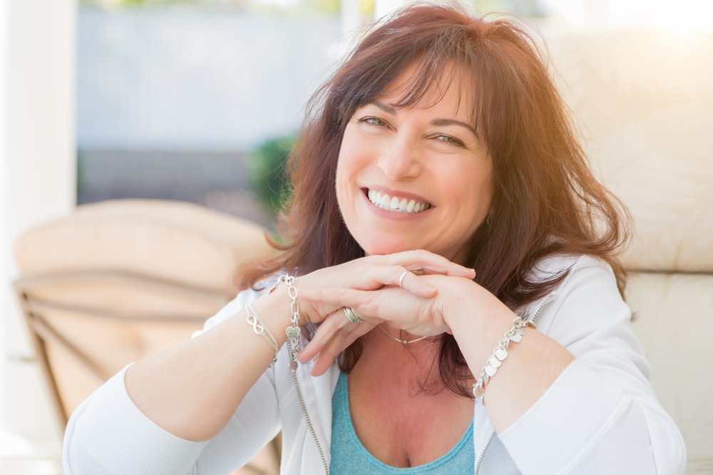 woman with dentures smiles
